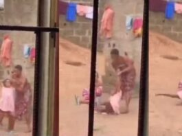Nigerian Woman filmed brutally assaulting her child and attempting to break her elbow while brushing her teeth(video)